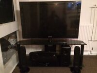 Samsung 40 inch tv, glass stand and home cinema system with dvd player