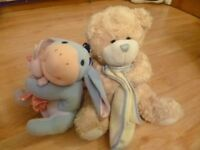 Soft Eeyore holding a rattle, & soft teddy holding a blanket