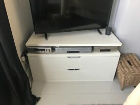 A Double drawer TV stand and shelf. Width 110cm depth 50 cm height 44cm