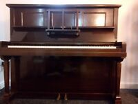 lovely upright piano in good condition