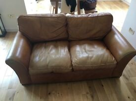 2 seater light brown leather sofa for sale. Used but in good condition.