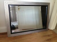 Large mirror with silver & black wooden frame