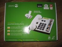 Amplified Photo Phone. Ideal if hearing is a problem. Bargain. Used once.