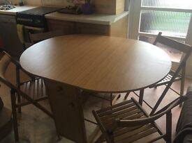 Foldable table with 4 chairs and drawer
