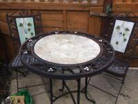 Wrought iron garden table and 4 chairs