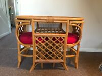 Wicker table and 2 chairs for sale .