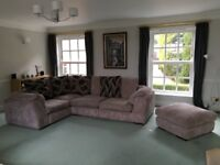 Right hand facing pillow back corner sofa with matching footstool