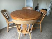 solid pine extending table and 4 chairs.
