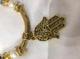 Gold tone and faux pearl Hamsa bracelet