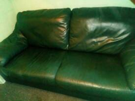 Green leather twin sofa