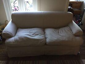 Cream coloured 3 seater sofa.
