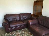 Two Four Seater Red Leather Settees