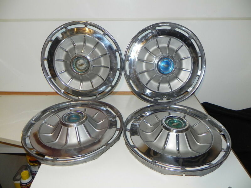 """4 Vintage Chevy Hubcaps  13"""" ?"""