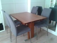 Walnut dinning table and 4 chairs