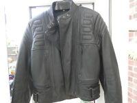 Ladies black leather motorcycle jacket.