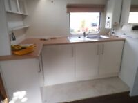 Small sink unit with cupboards