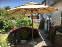 Excellent quality and condition, large parasol sunshade with tilt facility and stone base.