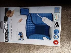 Heat pad for back and stomach. New unwanted gift still in box £5.00