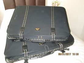 2 Large Wheeled Constellation International Suitcases.