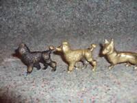 Miniature brass dogs