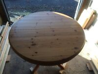 Pine Drum Table with Extension leaves.