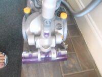 dyson dc08 all floor cylinder with a turbine head.