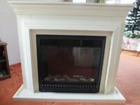 Fireplace surround and 2000w glass fronted electric fire with 3 heating position switches.