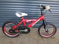 CHILDS FIRST BIKE IN EXCELLENT USED CONDITION.. (SUIT APPROX. AGE. 4+)..