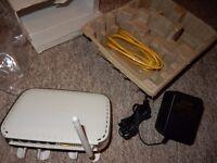 NETGEAR WGR614 v9 54 Mbps 4-Port 10/100 Wireless-G Router for Virgin Cable custo (A brand-new)