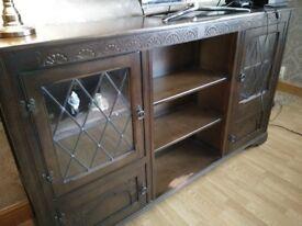 Dark oak sideboard. Has slight damage as shown in pics.