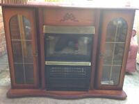 Olds style wooden fire surround with electric fire.