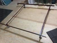 Steel bedframe with casters from double to twin size.