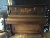 Upright piano, attractive inlaid case, tuned professionally around 3 years ago, suit beginner