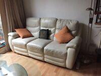 3 seater reclining cream coloured leather sofa