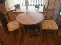 Wooden effect circle table and chairs with cushions