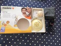 Medela Swing 2-phase breast pump with spares