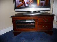 TV/DVD cabinet in dark wood veneer.