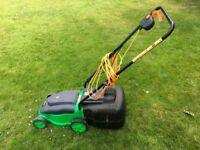 Variety of garden tools for sale including Powerbase lawnmower in good working condition