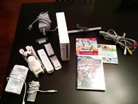 Console Wii + 5 jeux + 1 manette et chargeurs (140 $ négociable)