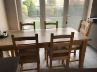 Sold wood table 6ft length 3ft wide with 6 solid chairs