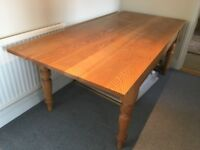 Solid ash kitchen/dining table. 200cms by 93cms and 75cms high. Seats up to 8.