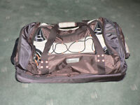 Large, wheeled, twin compartment, soft holdall.