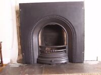 Cast iron fire place with wooden surround.