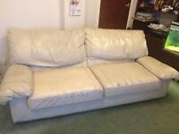 Two cream leather sofas