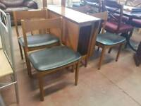 Teak table with 4 leather chairs
