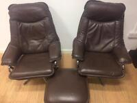 Vintage brown leather armchairs and stool