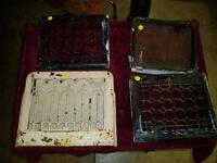 Variety of antique cast and metal furnace grates