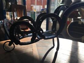 Horseshoe wheelbarrow plant holder