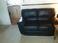 2 seater black leather sofa very good condition
