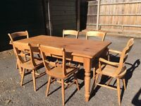 Solid pine farmhouse dining table and six chairs.